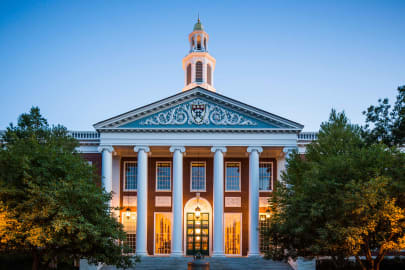 Baker Library-Bloomberg Center pillared entrance on the campus of Harvard Business School at dusk